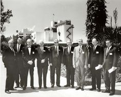 Group portrait outside Schlitz brewery, Van Nuys, late 1950s. Two men in the photo are identified: second from the left, C. Merle Duckett, and sixth from the left, Walter Burke. Valley Industry and Commerce Association. San Fernando Valley History Digital Library.