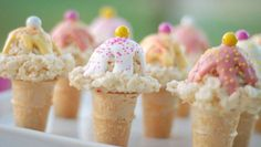 Rice Cream Cones - These mini faux ice cream cones are sure to thrill any kid, or kid at heart. Tiny cones are topped off with a scoop of crisp rice cereal and marshmallow, and garnished with candy. This recipe comes to us from Ashley of the blog Cute as a Fox.