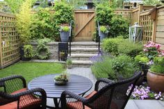 This yard may be small but it holds a number of amazing plants. The small garden is perfectly cozy and brings a great deal of life to this backyard.