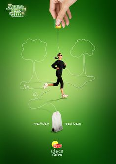 Lipton Clear Green tea print ad ... 'Step into the green side of life' depicts woman running through trees drawn with line of long string attached to teabag, c. 2000s