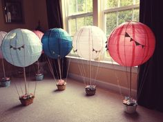 12 Hot Air Balloon Centerpieces- Absolutely Beautiful, I love these! Tall but keeps cost of flowers down . Could put battery fairy lights in the ballons for evening do. Love it!!! K x