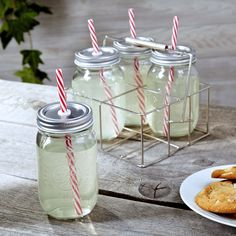 Serve your guests their ice tea or other mixed drinks in style with our Sippin Mason Jar drinking glasses with carrier. Each mason jar glass comes with a reusable straw and lid, making them perfect. Mason Jars, Canning Jars, Housewarming Party, Mason Jar Drinking Glasses, Drinking Jars, Pots, Buffet, Morning Drinks, Cooking Supplies