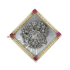 Fabergé ruby, diamond, enamel and gold brooch, the marquise shaped brooch with the Russian Imperial eagles motif in rose-cut diamonds on silver on an white coloured guilloché enamel background, with a yellow gold border with carved laurel design, set to the top, bottom and sides with a single round ruby, all mounted on red gold with the Russian marks for fourteen carat gold, stamped AH, August Holmstrom, St Petersburg 1898 - 1908