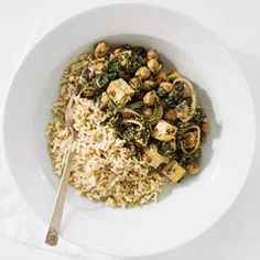 """Indian Saag with Chickpeas—to make this healthy Indian spinach stew recipe vegan, substitute tofu for the paneer and use """"lite"""" coconut milk instead of yogurt."""