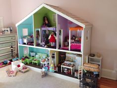 This dollhouse is 7 feet wide and a little over 6 feet tall.  Made in 2 separate pieces (1st floor & 2nd floor)  Only way to move it!!  The American Girl dolls love it!! so does our daughter!