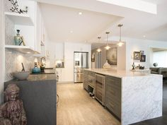 False Creek Condo for sale: A rarity in the City. This 3 bed 2 bath, 1765 Sqft corner unit, with a 426 Sqft patio, all on one level, is an absolute must see. House style living right on the sea wall, just steps to Granville island and the Marina. ...