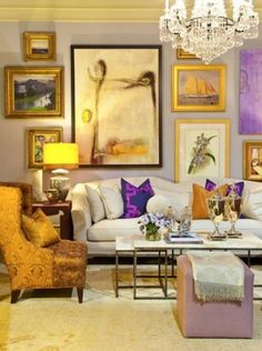 Great mix that complements the purple and gold palette. It's also nice to see that the focal point is not perfectly centered above the sofa.