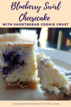 Blueberry Swirl Cheesecake pairs together buttery shortbread cookie crust with sweet, wild blueberry in a rich, decadent cheesecake! #cheesecake #baking #blueberry #beekeeperskitchen