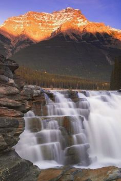 beautiful & powerful glacial waterfall, Athabasca Falls in the Canadian Rockies.