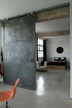 rough concrete, polished concrete, steel sliding door