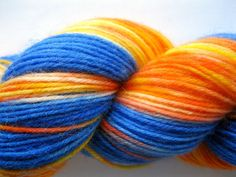 Fire and Rain - Hand Dyed Sock Yarn in blue, orange, yellow - fingering weight, superwash wool & polyamide - smaller skein approx. 386 yards