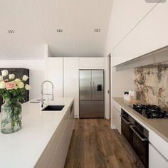 In keeping with the underlying modern classic theme, natural materials such as the French oak flooring and stone tile splashback provide an organic element. Living Room Modern, Kitchen Living, New Kitchen, Kitchen Modern, Living Rooms, Kitchen Interior, Kitchen Design, Kitchen Layout, Home Decor Sites