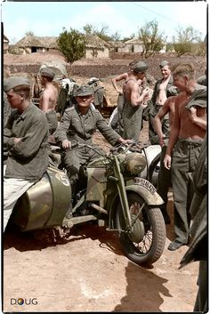 German soldiers gather around a French Gnome et Rhône AX2 800 motorcycle and side car in Belgorod, Russia. Summer 1943.