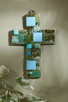 Magnificent! This gemstone wall cross is adorned with blocks of Turquoise, Jade and Abalone that create a bold statement. A unique addition to your home decor! May also be worn on a cord as a pectoral
