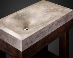 contemporary bathroom fixtures, concrete sinks in various colors