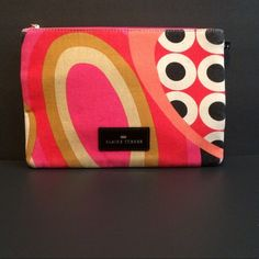 Elaine Turner Bag Elaine Turner Bag in Tan, Cream, Pink & Black. In Great shape see ends where a little rubbing off has taken place. Fully lined. Use as a clutch or makeup bag. Elaine Turner Bags Clutches & Wristlets
