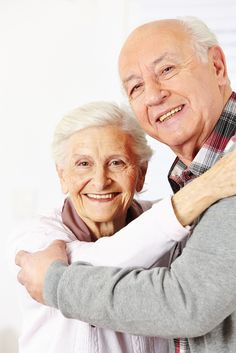 Happy senior citizen couple dancing together and smiling