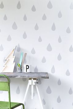 A beautiful raindrop motif wallpaper design, with drops in different sizes creating a gentle, restful backdrop for any child's room. Available in 4 colours silver, gold, pink and ice blue.
