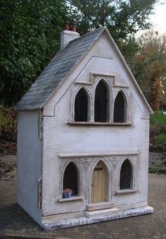 http://juliesdollshouseblog.blogspot.com  (I'm not sure if this is supposed to be a church. It may be meant to be a house, but with the Gothic windows and a door, I think it makes a lovely church.)