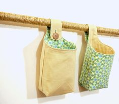 Hanging Storage Baskets, Two Blue and Tan Geometric Flower Fabric Hanging Baskets. $28.00, via Etsy.