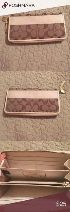 Coach zip up wallet Authentic coach zip up wallet with lots of compartments. In good used condition. 8x4 Coach Bags Wallets
