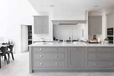 Shaker style doors and flat-fronted drawers sit within beaded frames and work surfaces are crowned in smooth Silestone for an effect that is both utilitarian and stylishly modern. Shaker Style Doors, Shaker Style Kitchens, Modern Grey Kitchen, Modern Kitchen Design, Bespoke Kitchens, Luxury Kitchens, Open Plan Kitchen, Kitchen Layout, Tom Howley Kitchens