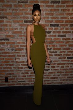 Chanel Iman rocks a figure-hugging olive halter dress with a sleek choker. See her top style moments on the ShopStyle blog.