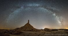 Striking peak of Castildetierra, a rock formation located in Bardenas Reales, a natural badlands in northeast Spain. Standing 50 meters tall, the rock spire includes clay and sandstone left over from thousands of years of erosion by wind and water. The astrophotographer waited months for the sky to appear just right -- and then took the 14 exposures that compose the above image in a single night. -Maria Rosa Vila