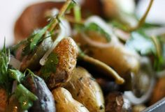 Roasted Marble Potatoes    James Papadopoulos, chef de cuisine at Sam & Harry's Steakhouse in Schaumburg, Illinois, roasts baby potatoes with extra-virgin olive oil, whole cloves of garlic and fresh thyme. Once they're tender, he tosses in some sliced caper berries (which are milder than capers) for a bright bite of acidity, akin to the pep a dash of vinegar gives to a plate of fish and chips.