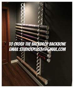 Backdrop Storage 6 Foot Wall Mounted System. It Holds At Least 20 Backdrops.