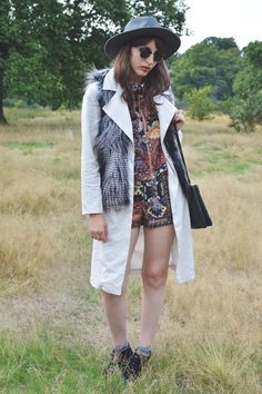 Blogger Two Shoes One Pair wears a 70s inspired transitional outfit with gilet, trench coat and folk print co-ord #streetstyle #seventies