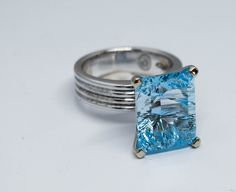Custom white gold ring with a ctw brilliant blue Topaz White Gold Rings, Silver Rings, Blue Topaz, Gallery, Jewelry, White Gold Wedding Rings, Jewlery, Roof Rack, Jewerly