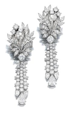 PAIR OF DIAMOND PENDENT EARRINGS. Each earring featuring a surmount of floral design suspending a tassel motif, set with marquise-, pear-shaped, brilliant-cut and baguette diamonds, post fittings
