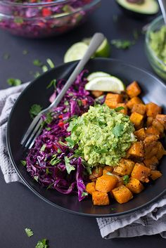 Roasted butternut squash, black bean & cabbage slaw and a quick guacamole. It's everything I love in a burrito bowl, plus extra guacamole, obviously.