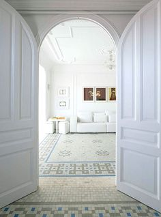 How refreshing it is to live in a entirely white space? This TrendHome apartment located in Barcelona feels like pure and serene, the mix between the all white environment and the touch of colors with the art pieces, the strong architectural elements such as the mosaic floor, the high ceiling and the elements from the past and present defines this beautiful Catalonia home. Lovely!