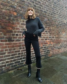 Lizzy Hadfield | charcoal grey cable knit crew sweater, black kick flare denim, black ankle heel boot