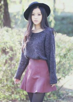Purple sweater with a soft fuschia skirt and tights and a hat