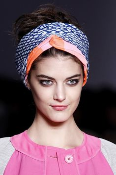 Tie an oversized head scarf in your hair; it's the ultimate summer hair accessory.