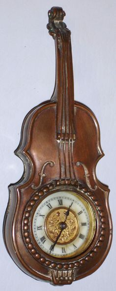Antique Clock in the shape of a violin. #clock #violin #antique
