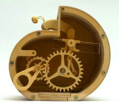 Check out this entertaining mechanical bank with exposed workings. This ingenious device by artist...