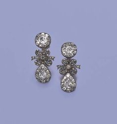 A PAIR OF ATTRACTIVE LATE 18TH CENTURY DIAMOND EARRINGS   Each designed as an old-cut diamond cluster drop to a ribbon bow and circular cluster detachable top, mounted in silver and gold, circa 1780, in later fitted case