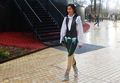 Street fashion from Paris Fashion week.Liu Wen in Louis Vuitton