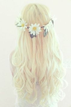 Fairytale blonde hair with a flower headband.