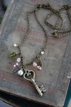 Antique Brass Skeleton Key Beaded Necklace - 18 inch. 13.00, via Etsy.