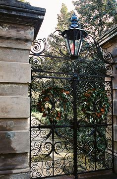 Garden entrance with a wrought iron gate and an old fashioned street lamp, two of my favorite things