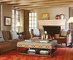 Though large in size, this luxurious living room offers a cozy welcome, thanks to a combination of natural materials, plush textures, and posh forms done up in toasty hues: http://www.bhg.com/rooms/living-room/makeovers/living-room-decorating-ideas/?socsrc=bhgpin060414cultivatewarmth&page=15
