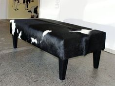 A classic black and white cowhide ottoman by Gorgeous Creatures who are a cowhide ottoman and leather decor specialists. www.gorgeouscreatures.co.nz or www.cowhideottoman.com.au