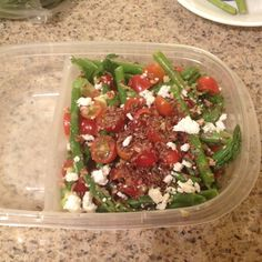 Asparagus Salad:    - Cooked asparagus (boil till dark green then soak in ice water before serving) - Cherry Tomatoes - Avocado - Sprinkled with Flax Seeds, Feta and Walnuts