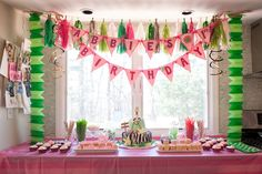 Jungle/Safari themed first birthday party, complete with tissue paper garland from Etsy, a giraffe zebra cake, and handmade flags. Flags and desgin by Mikkel Paige Photography. #firstbirthday #babygirl #green #hotpink #pink #jungle