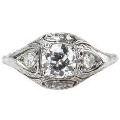 Enchanting Art Deco Engagement Ring with Floral Engraving